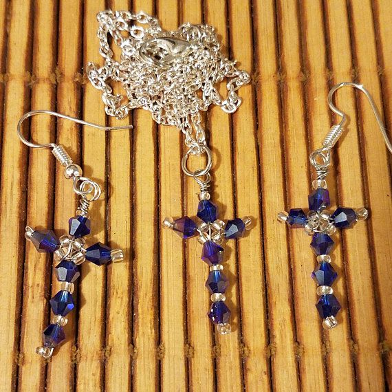 Blue Crystal Cross Necklace and Earrings available now at KarenSukiArts on Etsy. Each cross pendant is hand beaded.
