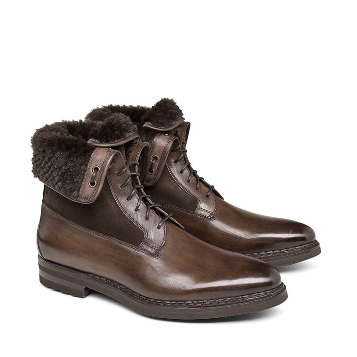 Brown leather combat boots with slender toes and tone-on-tone suede inserts. Finished with porcupine leather lining and coordinated leather laces. A powerful model with a sporty attitude completed by a leather sole.