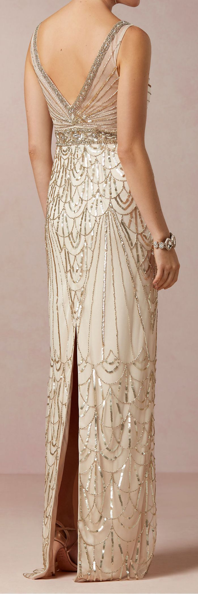 This gown is absolutely darling, the pattern all beaded, feminine with an touch of elegance, again following the Art Deco pattern, simple but stunning.