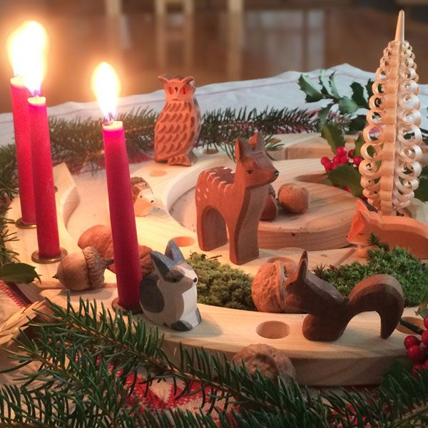 Birthday or Advent Spiral Decoration by Grimm's, decorated with Ostheimer animals and an Erzgebirge Spanbaum shaved wood tree.