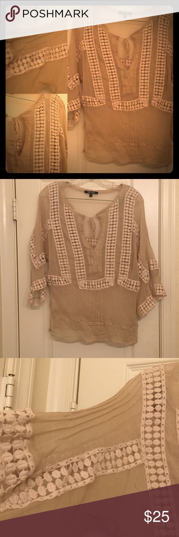 Ladies Sheer Bohemian Blouse with detailed sleeves Ladies Sheer Bohemian Blouse with detailed sleeves. Purchased from Anthropology/ it came with a tank top under it but I don't have it anymore. It can be worn with a nude bra under it. It has a very Bohemian feel to it. Size Large. Daniel Rainn design. Anthropologie Tops Blouses