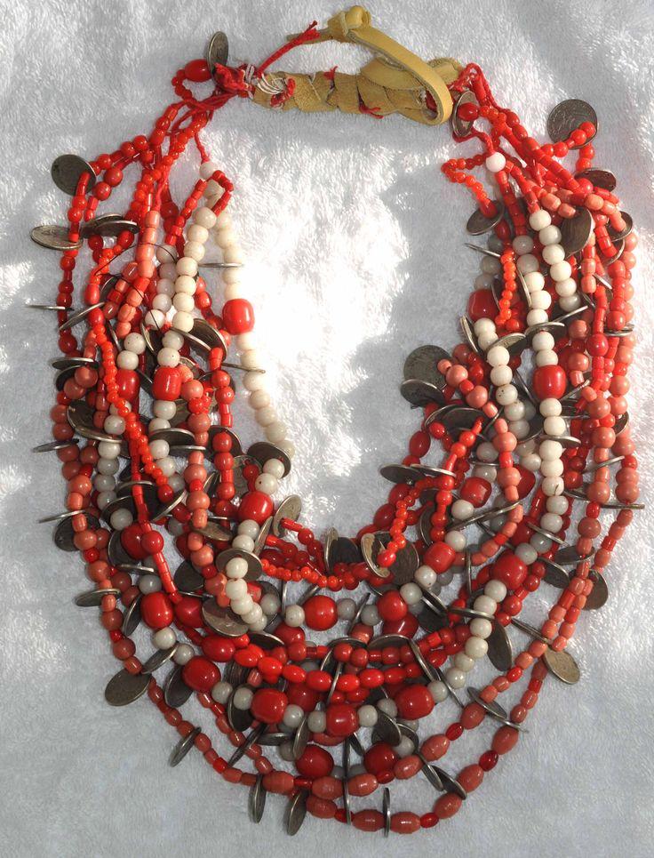 Ecuador | Original coin and bead necklace worn by the Otavalo Indians. | © Linda Pastorino