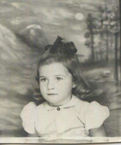 Vintage photo booth portrait. BRIGHT EYED LITTLE GIRL.