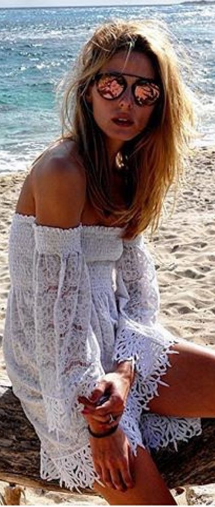 Who made  Olivia Palermo's white off the shoulder dress and rose gold sunglasses?