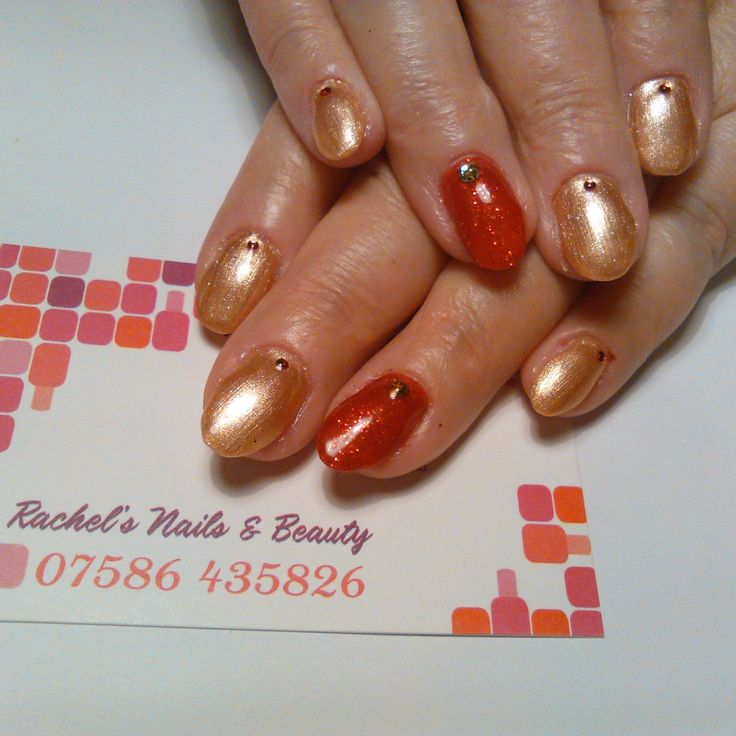 Oval Bio Sculpture Gel sculptured extensions using No. 167 Seductive Lights & No. 169 The Rebel, with Naio's Ruby and Gold rhinestones.
