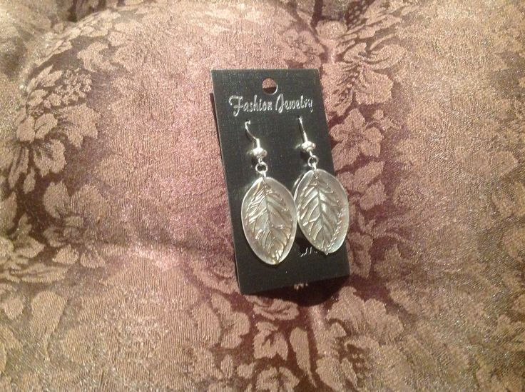 Earrings, made from silver plate teapot bowls, flattened and enhanced with metal leaf beads.