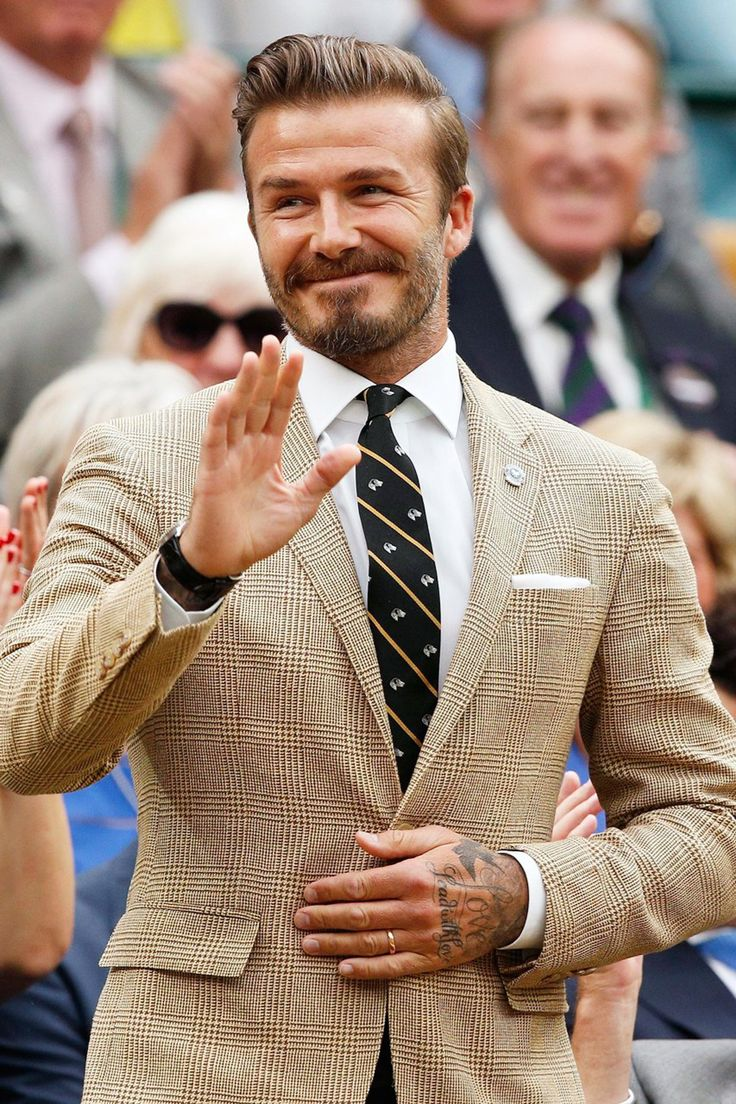 David Beckham, wearing a Ralph Lauren suit, was applauded by the crowd as he took his seat on Centre Court.