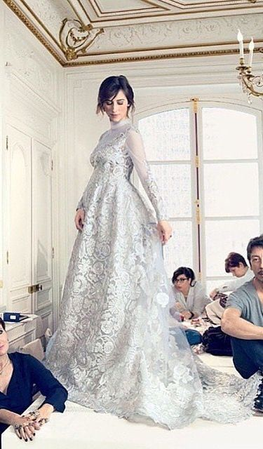 Sophie Hunter in a long sleeved Valentino Couture Wedding Gown that she wore to marry Benedict Cumberbatch. The gown was inspired by Anna Karenina and unicorns.