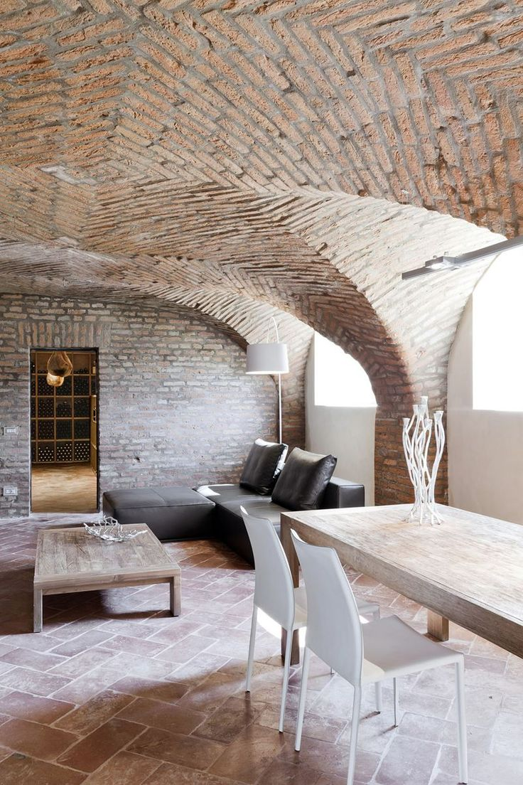 138 best materials bricks images on pinterest architecture stunning basement remodel featuring exposed brick walls and ceilings tile floors wooden table white chairs and modern furniture throughout dailygadgetfo Gallery