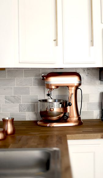 Countertop appliances don't have to be an eyesore. Instead, find ways to incorporate them into your kitchen decor. Take this @kitchenaidusa Professional Stand Mixer as an example. Not only is the color of the appliance pretty on its own, but the matching accessories and cabinet hardware bring the entire look together.