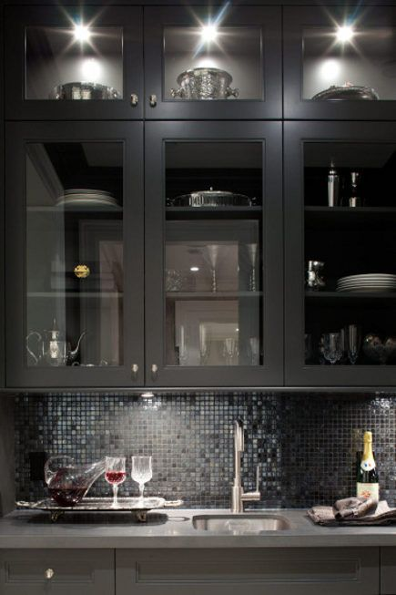Glass mosaic can be tricky but the slight iridescence in this butler's pantry gives it a modern sophistication