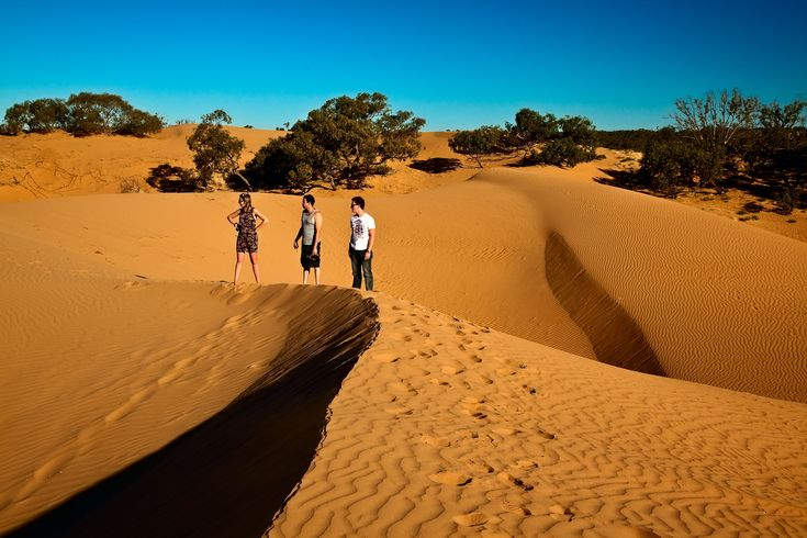 Three Aussie tourists at the Perry Sandhills near the town of Wentworth in south western NSW, Australia.