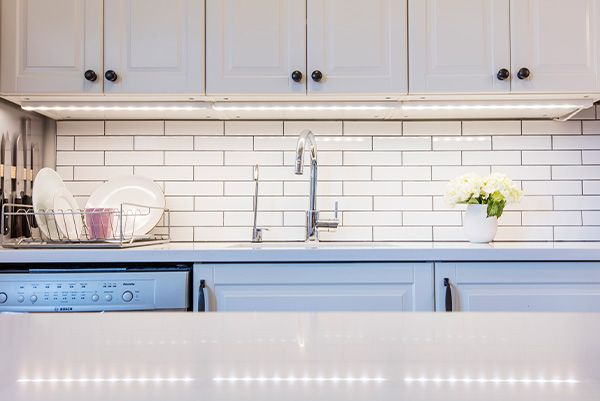 Looks we LOVE: classic white subway tiles + under-cabinet LED lighting