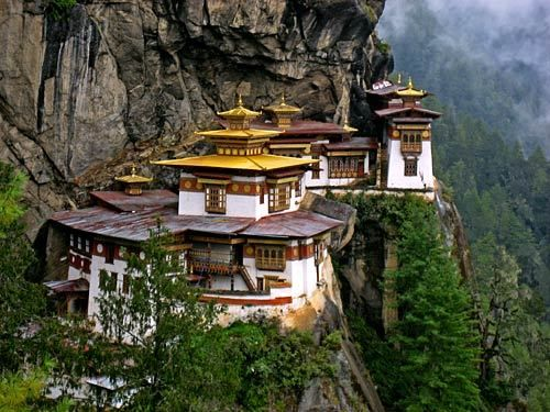 Taktsang Monastery, also known as the Tiger's Nest, clings to the slide of a cliff about 10,000 feet above ground in Bhutan's Paro district. The monastery was built in the 17th century and damaged in a fire in 1998.  Visitors can reach the monastery by mule ride or by foot. Walking takes about two hours from the base of the trail. The monastery is still used, and entry is restricted.  More info: http://www.tourism.gov.bt/destinations/brief-description-5.html  -- Jason La