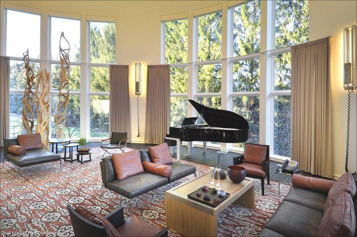 Beautiful Modern Living Room With Organ Beside The Glass Window.
