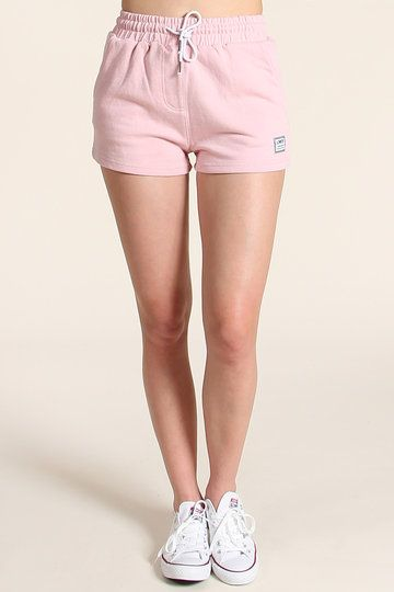 Every girl needs a pair of slouchy shorts. It's called Sunday. You settle on the couch with pizza, popcorn and a box set of something set in California. You wear Lower's Slouchy Shorts and you stay there for eight hours straight. Heaven.