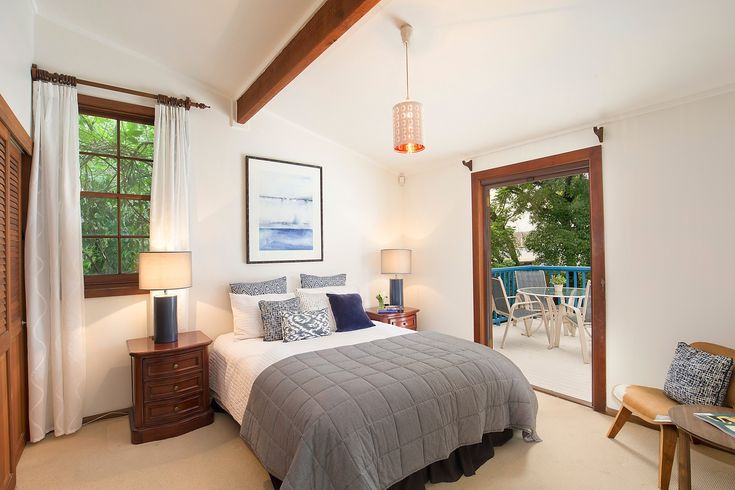 Main bedroom, exposed beam, sitting chair, throw, throw cushions, manchester, side tables, table lamps, wall art, Pilcher Residential