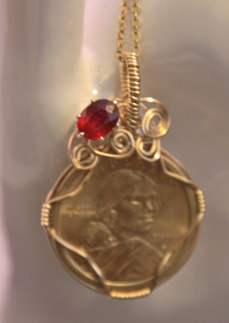 Sacagawea Dollar wrapped with 14K gold filled wire with garnet accent by LomaCreations on Etsy