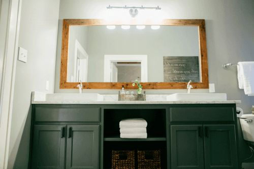 Fixer Upper | Season 2 Episode 1 | I kinda like the big mirror trimmed out with a frame. Also, the two sinks, I like that style.