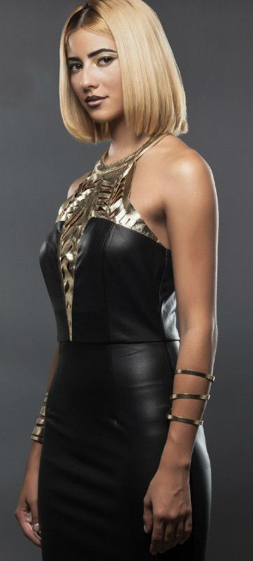 Showstopper Bodycon Black Leather with Gold Cutoff Dress featuring V-Neck Cutoff in Metallic Gold Leather Fabric Invisible Zipper at the back Material: Polyester/Spandex Color: Black/Gold Models are w