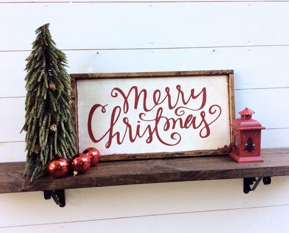 Merry Christmas Wood Sign Christmas Sign  It is 13 1/2 x 25 1/2 with its frame which is stained a dark walnut It hangs from a framed ledge on the back so no hanging hardware is needed  It is white with red letters CUSTOM COLORS AVAILABLE  Our signs are rustic, hand painted and distressed so again there will be imperfections and no 2 will be alike  $50 + $20 s&h *** on sale this week only $40 + $20 s&h ***