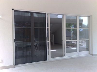 Door screens retractable screen doors and windows for Genius retractable screen