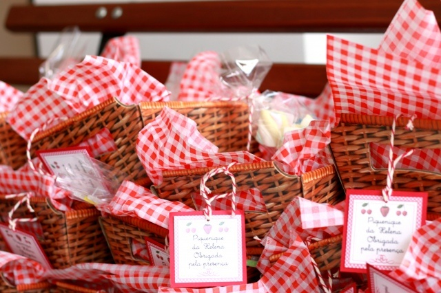 A cool party favor for a picnic-themed birthday party: a mini takeaway picnic for each child, containing a chocolate chip cookie, an apple, a juice box, some marshmallows and a bottle of bubble solution!