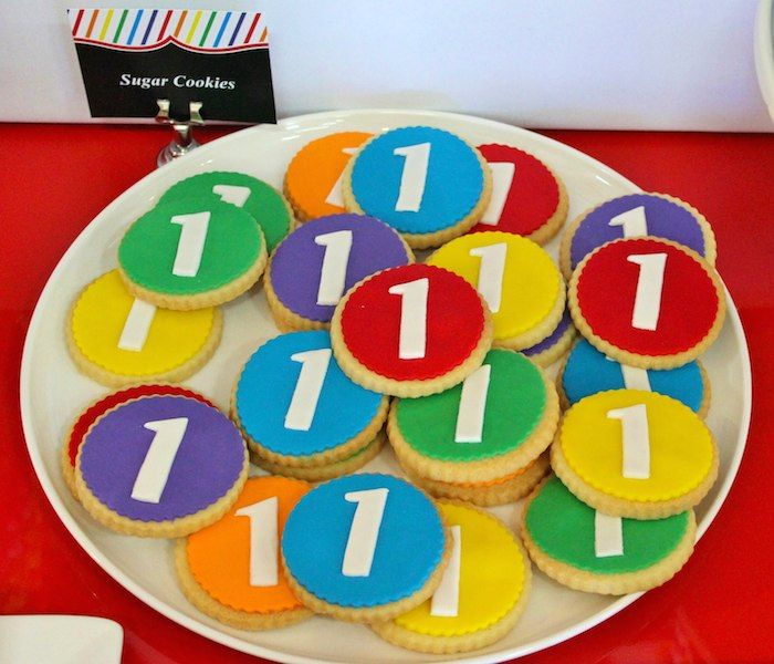 Rainbow themed 1st birthday party via Kara's Party Ideas! Cakes, cupcakes, printables, recipes, games, and more! KarasPartyIdeas.com #rainbo...