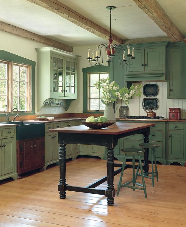 Such a cozy kitchen! Wonderful beam ceiling and I love the two shades of green cabinets. Lovely!