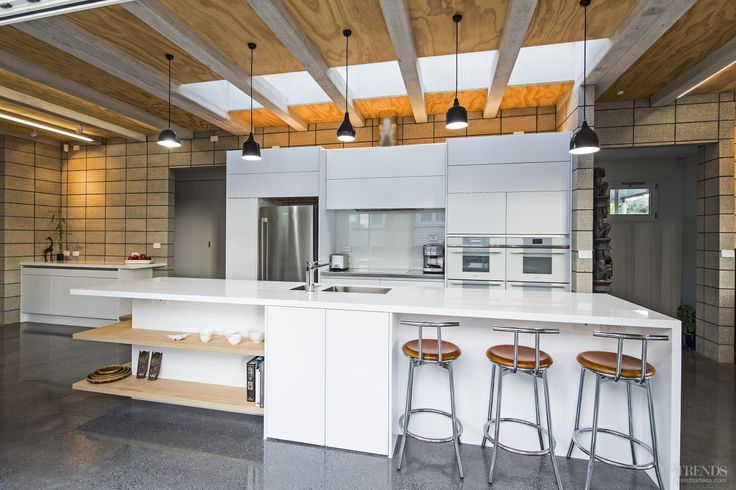 Even the appliances are a perfect match in this white contemporary kitchen