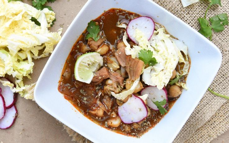 In this recipe for red pozole, jackfruit replaces the shredded meat, and chickpeas add substance. What makes this a red pozole rather than white pozole is the addition of spicy chili paste, which takes the flavor to the next level.