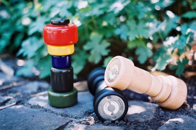 Muuto salt and pepper grinders (the colourful one for pepper and the natural wood for salt)