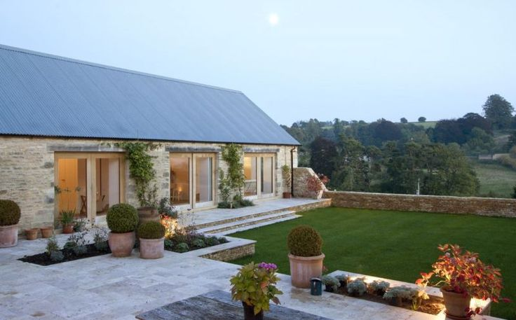 Large Barn view of bedrooms to the right of kitchen. (single door with plinth and stone surround to right and left)