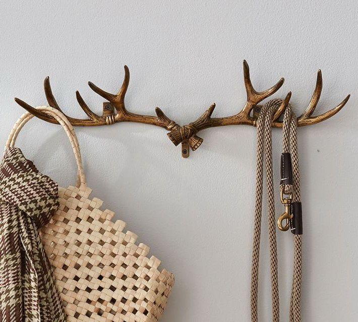 Рога в интерьере: головы оленя и лося, светильники и мебель