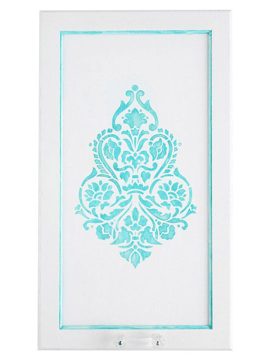 Kitchen Cabinet Makeover: Stylish Stenciled Doors Add panache to your kitchen by stenciling your cabinet doors.