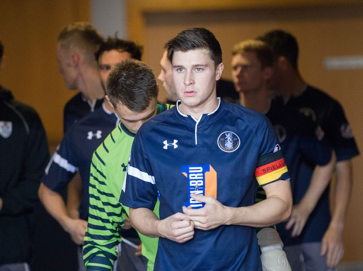 Queen's Park's Sean Burns leads his team out before the Betfred Cup game between Queen's Park and Edinburgh City.