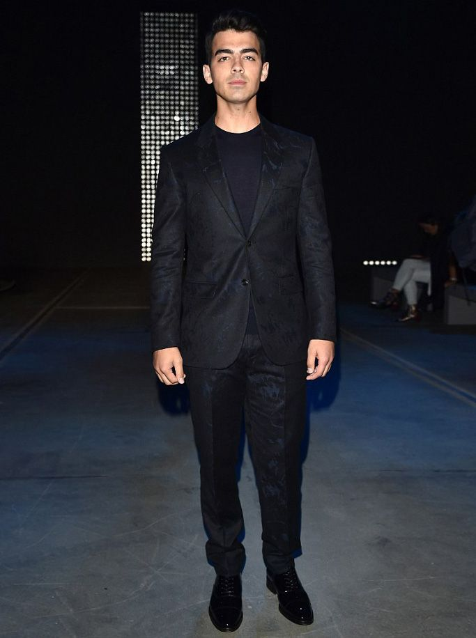Joe Jonas sports head-to-toe Versace at Milan Fashion Week #versace #joejonas #milanfashionweek #suit #springsummer2016