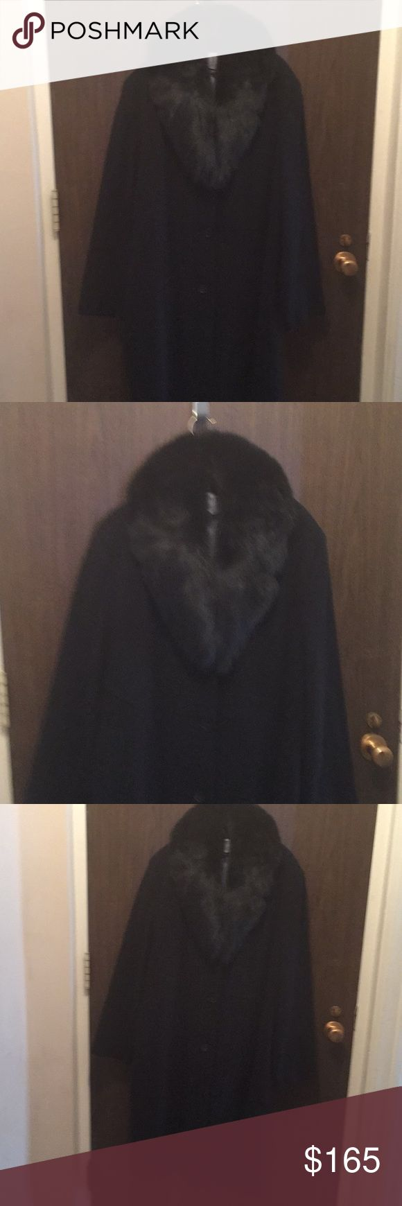 ANDREW MARC REAL FUR COLLAR BLACK COAT NEVER WORE Has fabric content listed in photos. Big beautiful blue fox real fur collar that you can take off if you prefer. Three black buttons open and close the front. Has a grey or silver grey satin lining no pleat or vent in the back . It been hanging in my closet I never wore it just tried on. Never been worn. MARC NEWYORK by Andrew Marc Jackets & Coats