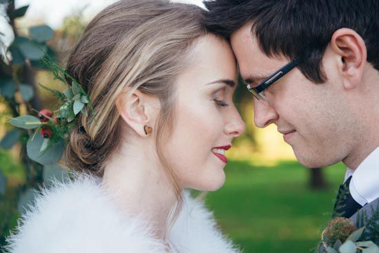red lipstick / bride and groom / perth wedding / feather fur wrap / outdoor ceremony / core cider house / winter wedding / rustic glamour styling  Rustic Winter Orchard Wedding Inspiration featured on Polka Dot Bride captured by Earthbound Images http://www.earthboundimages.com.au