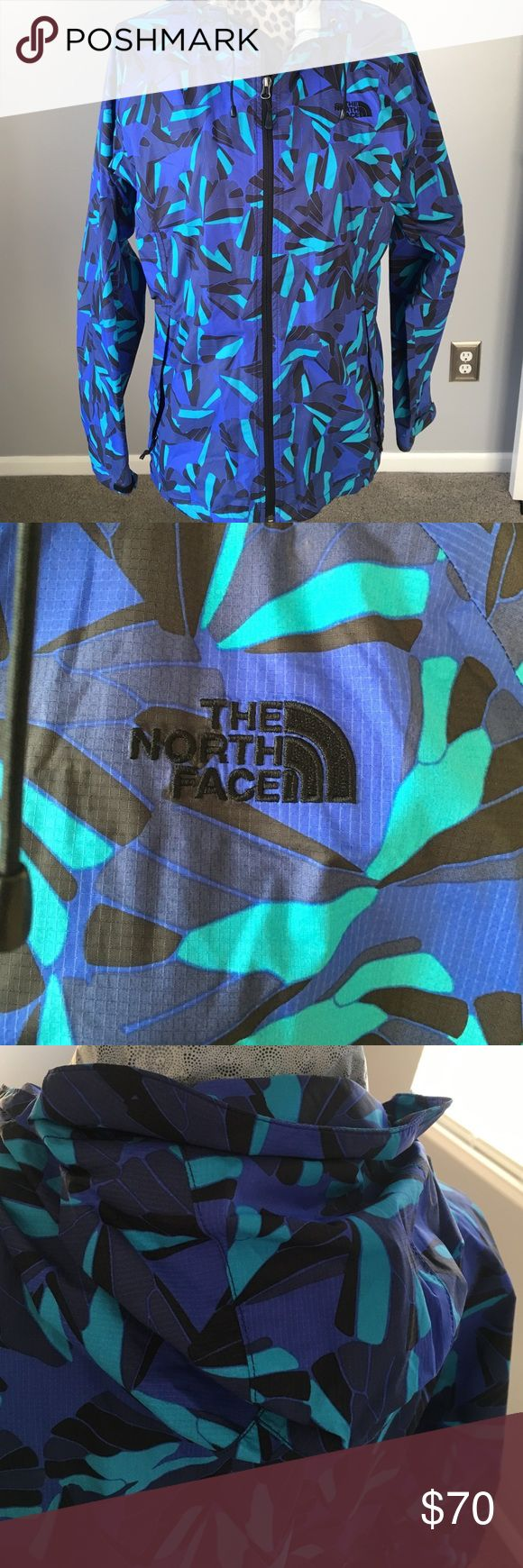 North face wind breaker Multi color Northface windbreaker/rain jacket. Excellent condition. Has hood and 2 zippered side pockets North Face Jackets & Coats