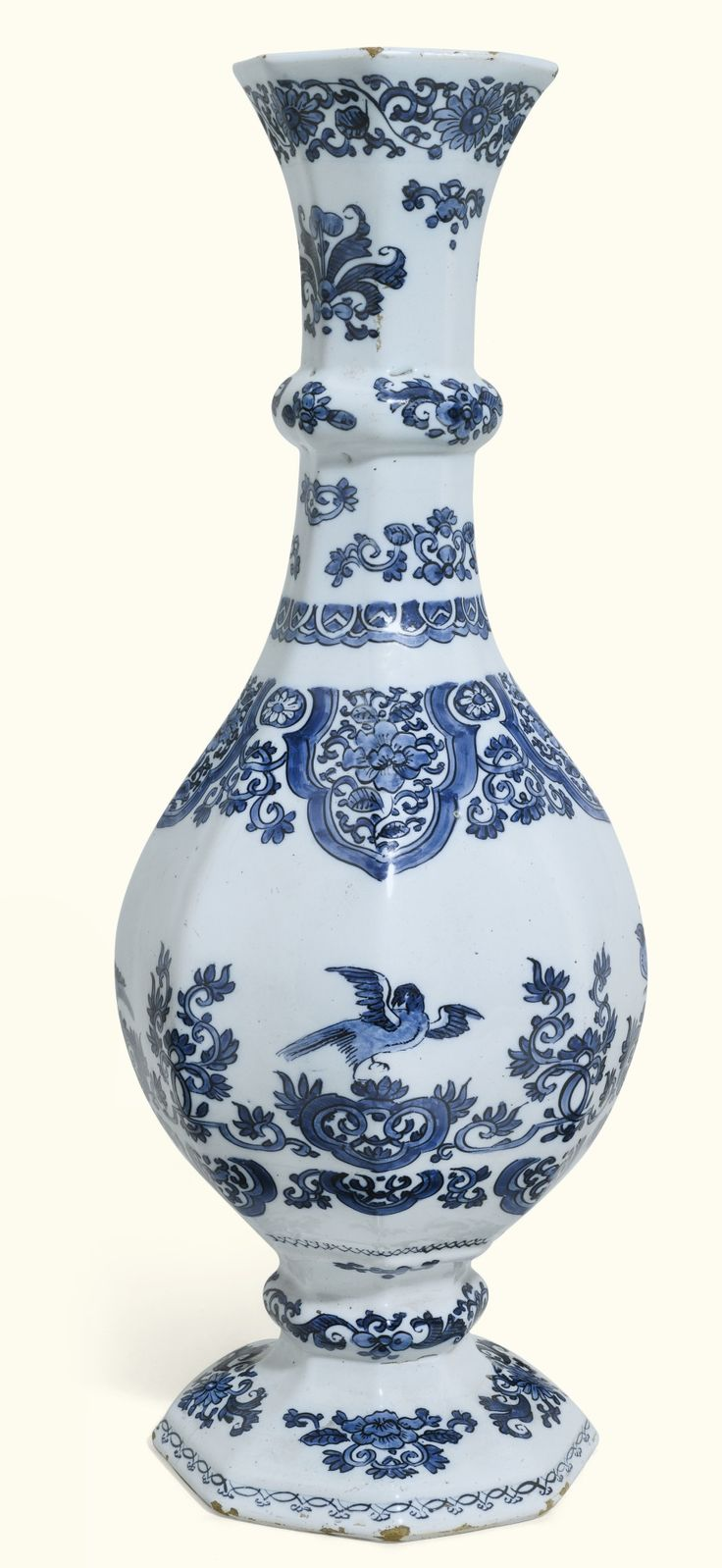 A Tall Dutch Delft Blue And White Octagonal Bottle Vase