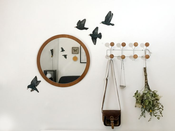 Wooden screen printed starlings  by Jenny McCabe. interior bedroom with reflections in mirror