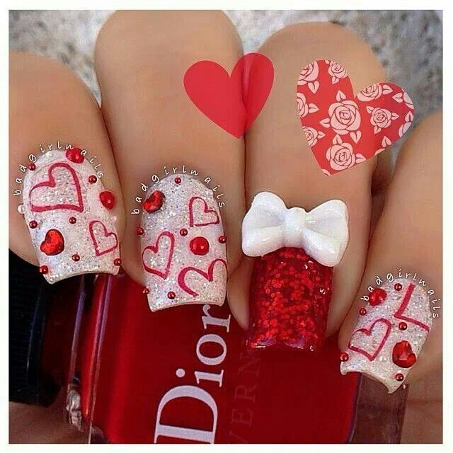 A little over the top, but I love the red hearts on the white glitter nails with the red accent nail! #nail #nailart #manucure