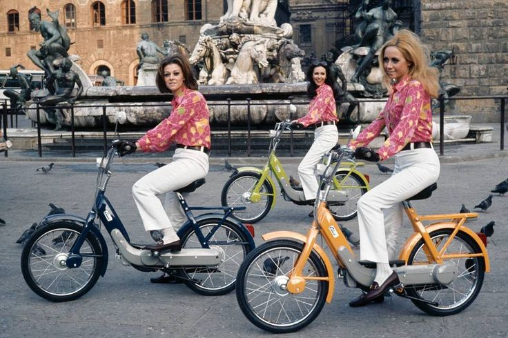 SPOKESPEOPLE | Models riding Piaggio Ciao mopeds at the Fountain of Neptune in Florence, Italy,...