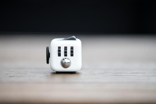 Fidget Cube - $22, An unusually addicting, high-quality desk toy designed to help you focus. Fidget at work, in class, and at home in style. Fidget Cube has six sides. Each side features something to fidget with: Click. Glide. Flip. Breathe. Roll. Spin.