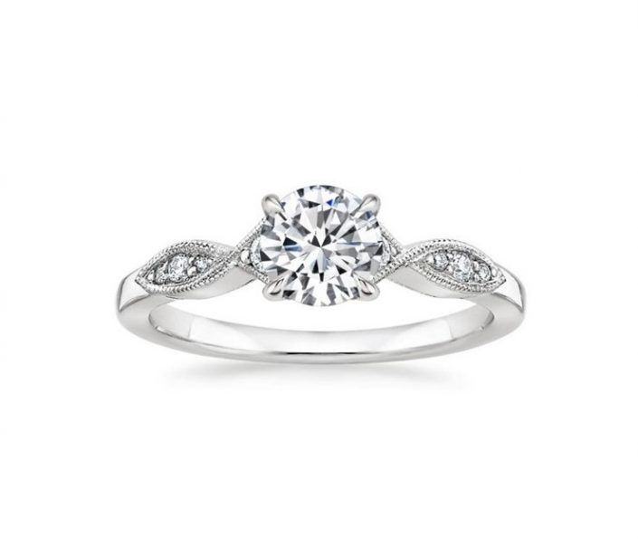 ''Prima'' Vintage Diamond Engagement Ring This romantic setting features overlapping ribbons of precious metal that form a subtle infinity design around brilliant diamond accents.