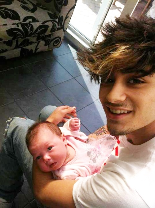 Zayn Malik and Perrie Edward's baby cousin << Another one who needs lessons on how to hold a baby