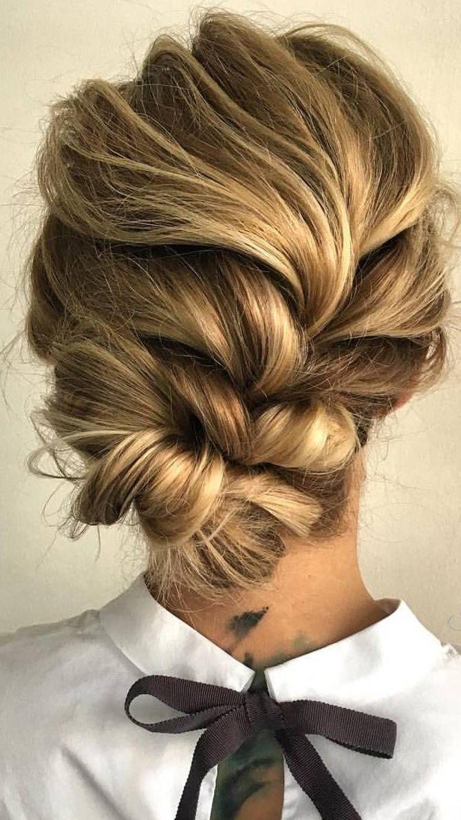 Coiffure cheveux longs - Tresse loose terminée en chignon style coiffé-décoiffé très tendance