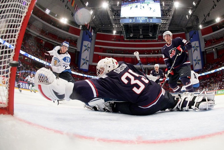 STOCKHOLM, SWEDEN - MAY 19: Finland's Lauri Korpikoski #28 scores on USA's John Gibson #35 while Jeff Petry #2 looks on during bronze medal game action at the 2013 IIHF Ice Hockey World Championship. (Photo by Andre Ringuette/HHOF-IIHF Images)