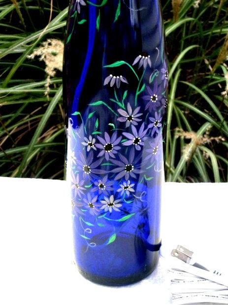 17 best images about wine bottle ideas flowers on for Painting flowers on wine bottles
